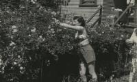 [Photograph of Jennie working in garden]