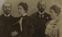 [Photograph of two men and two women]