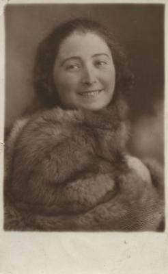 [Photograph of unidentified young girl wearing fur]