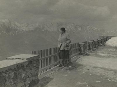 [Photograph of Rosa Baltuch looking over railing at mountain view]