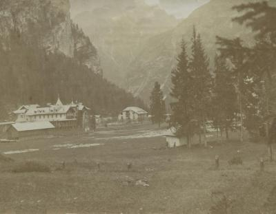 [Photograph of buildings with mountains in background]