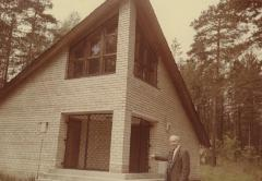[Photograph of Boris Shak standing in front of building in Ponary]