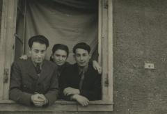 [Photograph of Boris Shak and identified man and woman posing in window]