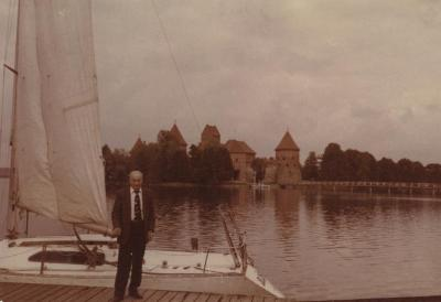 [Photograph of Boris Shak standing in front of boat in Vilnius]