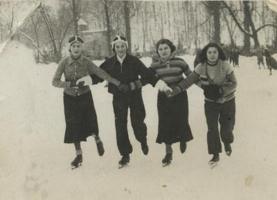 [Photograph of Ida Kaplan skating with friends]