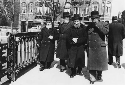 [Orthodox Jews crossing bridge]