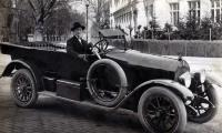 [Portrait of Leopold Gottfried seated in a convertible automobile]