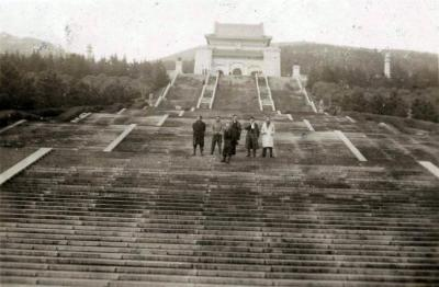 [Image of Manfred Gottfried and a group of men on the stairs to Dr. Sun Yat-sen's Mausoleum]