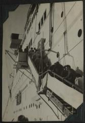 [Photograph of people boarding a ship]