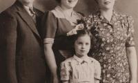[Photograph of Molly Knoll with parents and sister]