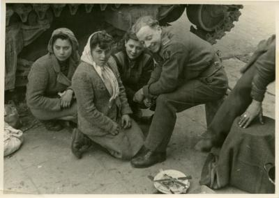 British Tommies (Desert Rats) chat with Czech slave girls just liberated from slave camps, Hamburg