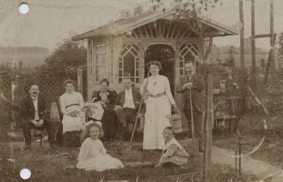 [Photograph of Bick family posing in garden]