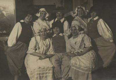 [Photograph of eight women wearing costumes]