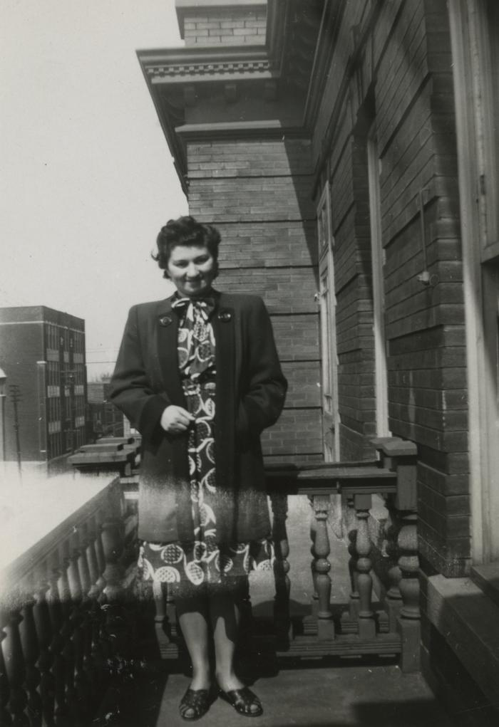 [Photograph of Jennie in print dress and coat]