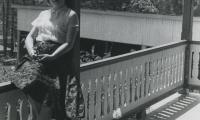 [Photograph of Jennie sitting on verandah railing]